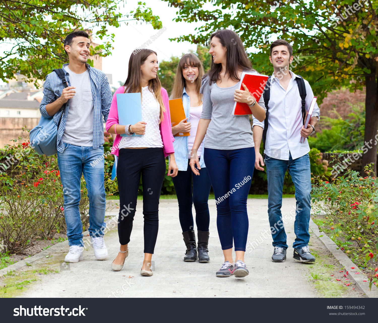 Group College Students Walking Together Stock Photo