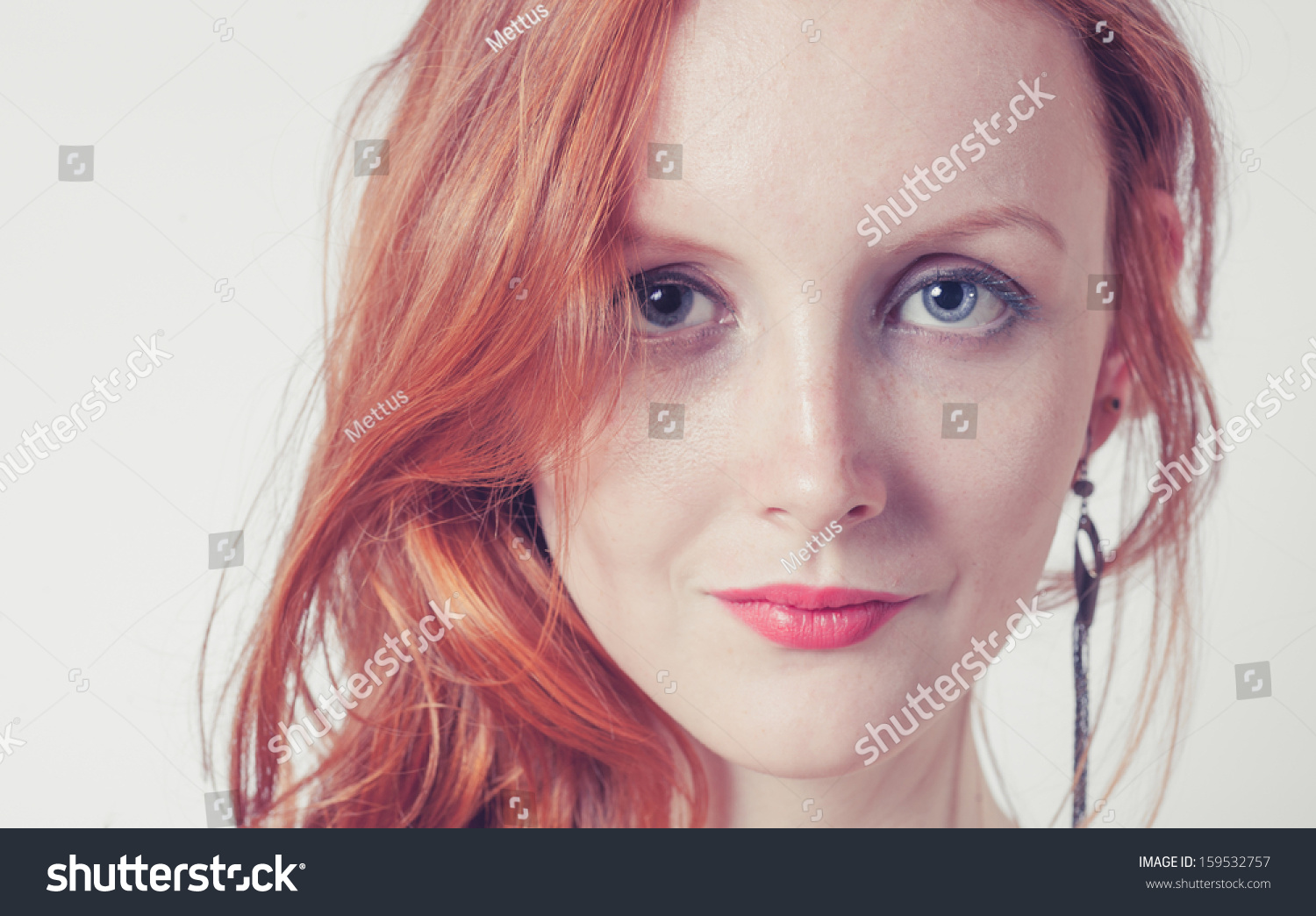 Toned image of the Beautiful sexy woman with red hair (ginger haired or carrot top)