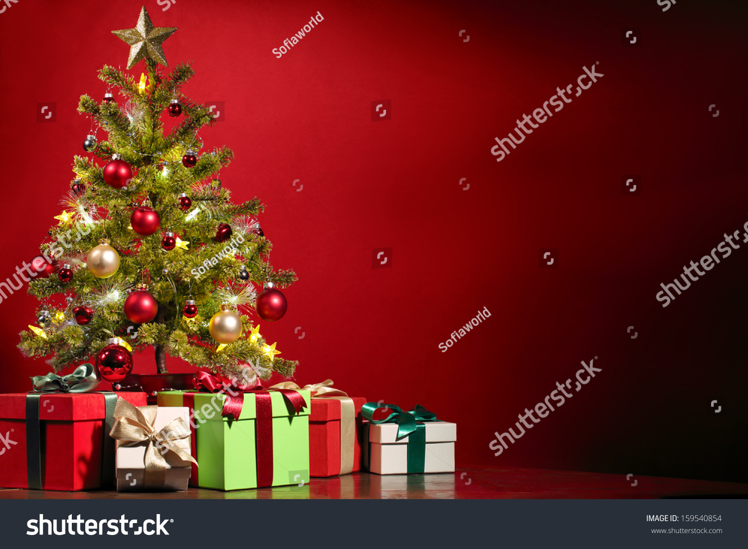 Christmas tree with presents and lights - Christmas Tree With Gifts On Red Background