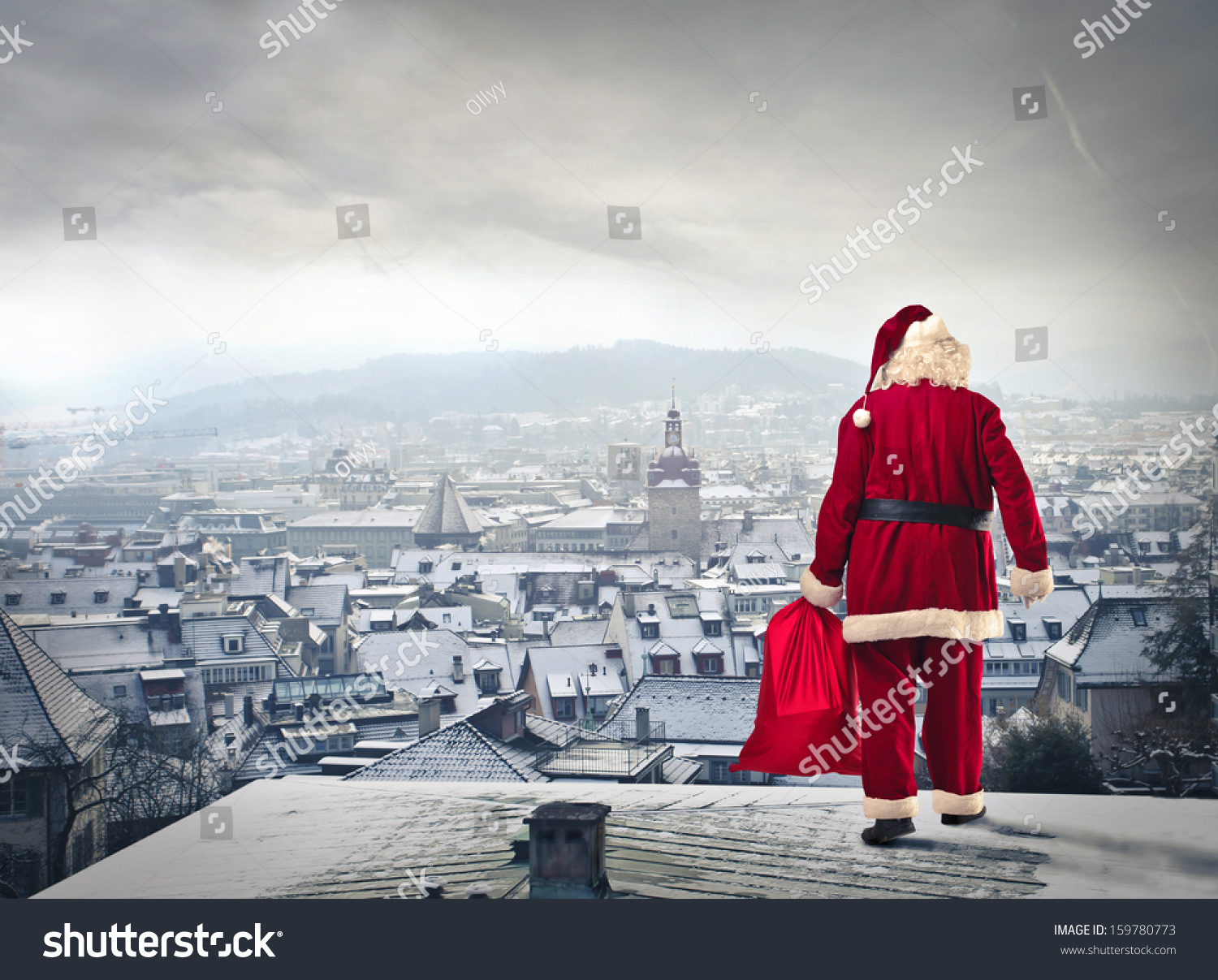 Santa Claus Over The City With Red Sack Stock Photo