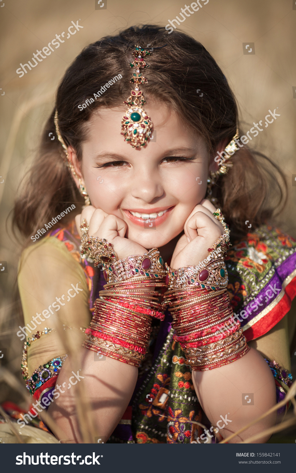 Happy Little Indian Girl Outdoors Traditional Stock Photo