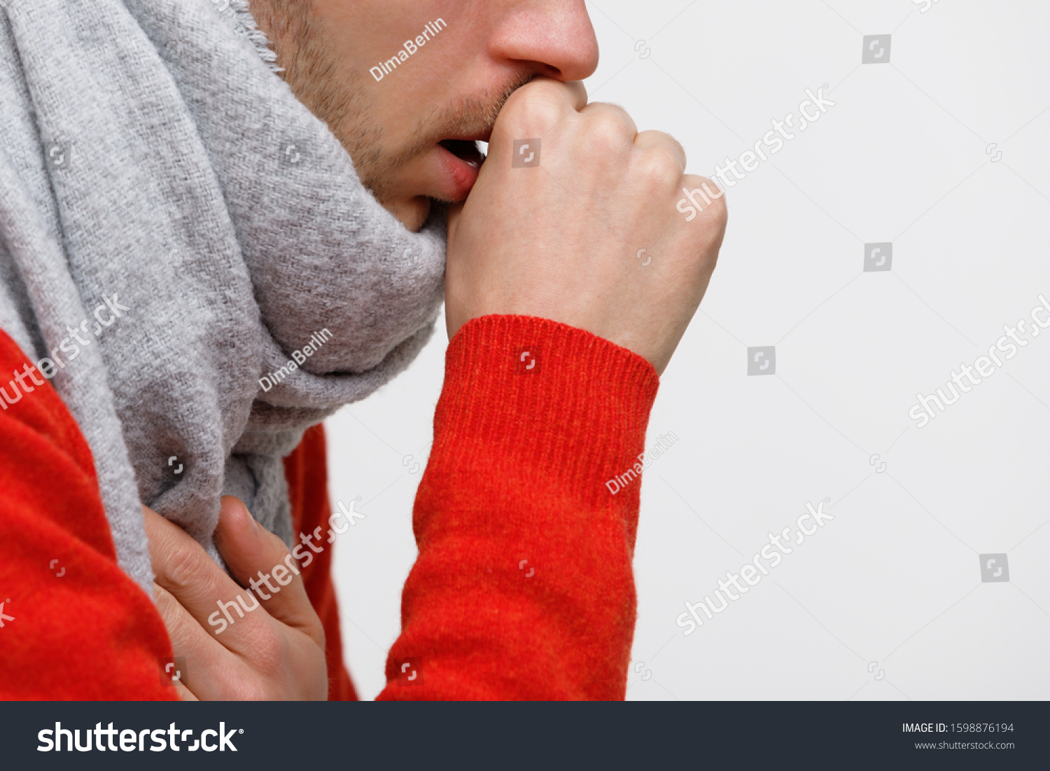 Close up of unhealthy man in orange sweater suffering with pulmonary cough due to cold, flu, respiratory infections, pneumonia, bronchitis, wrapped in scarf, isolated on white background.  #1598876194