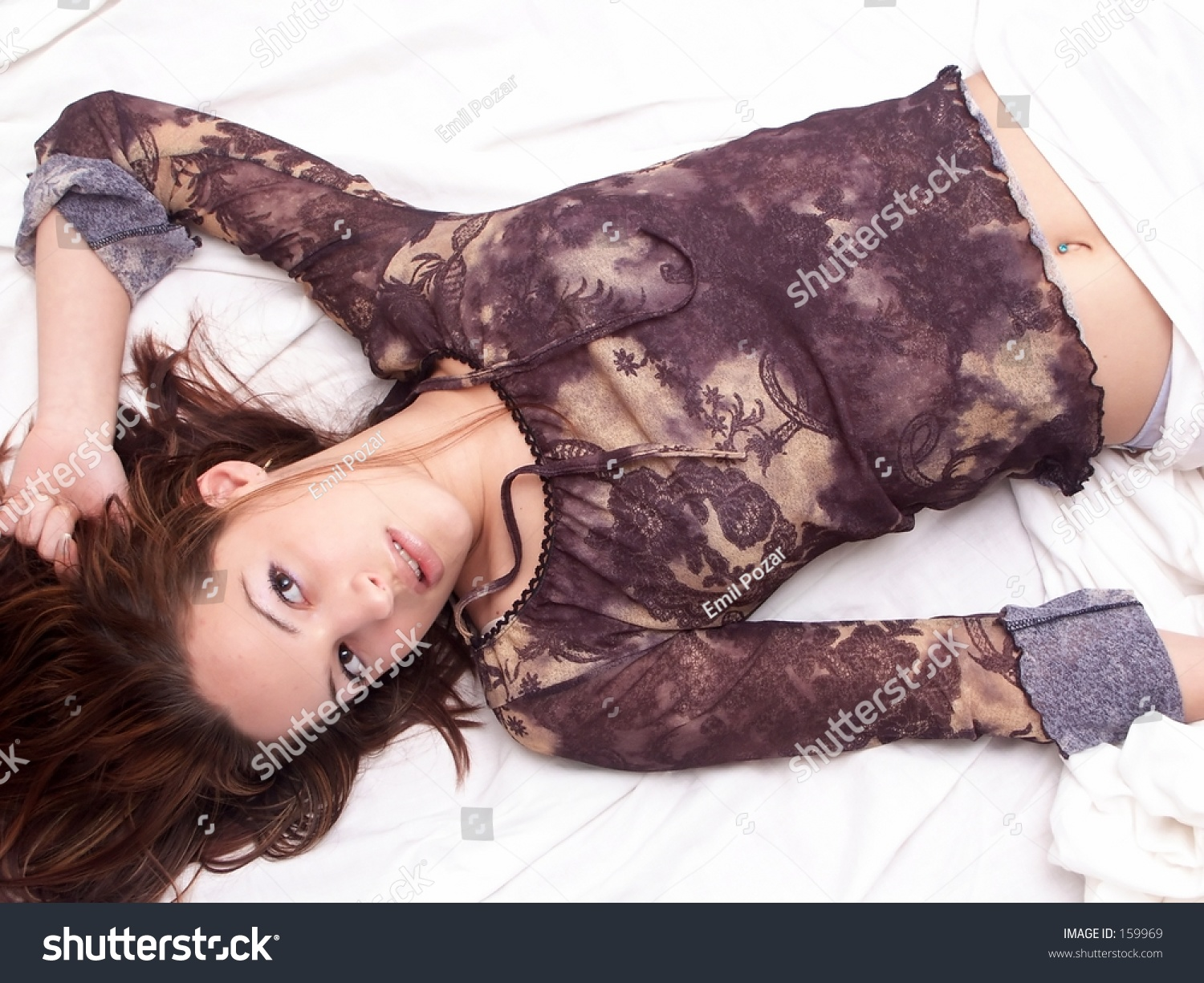 girl laying in bed stock photo 159969 shutterstock. Black Bedroom Furniture Sets. Home Design Ideas