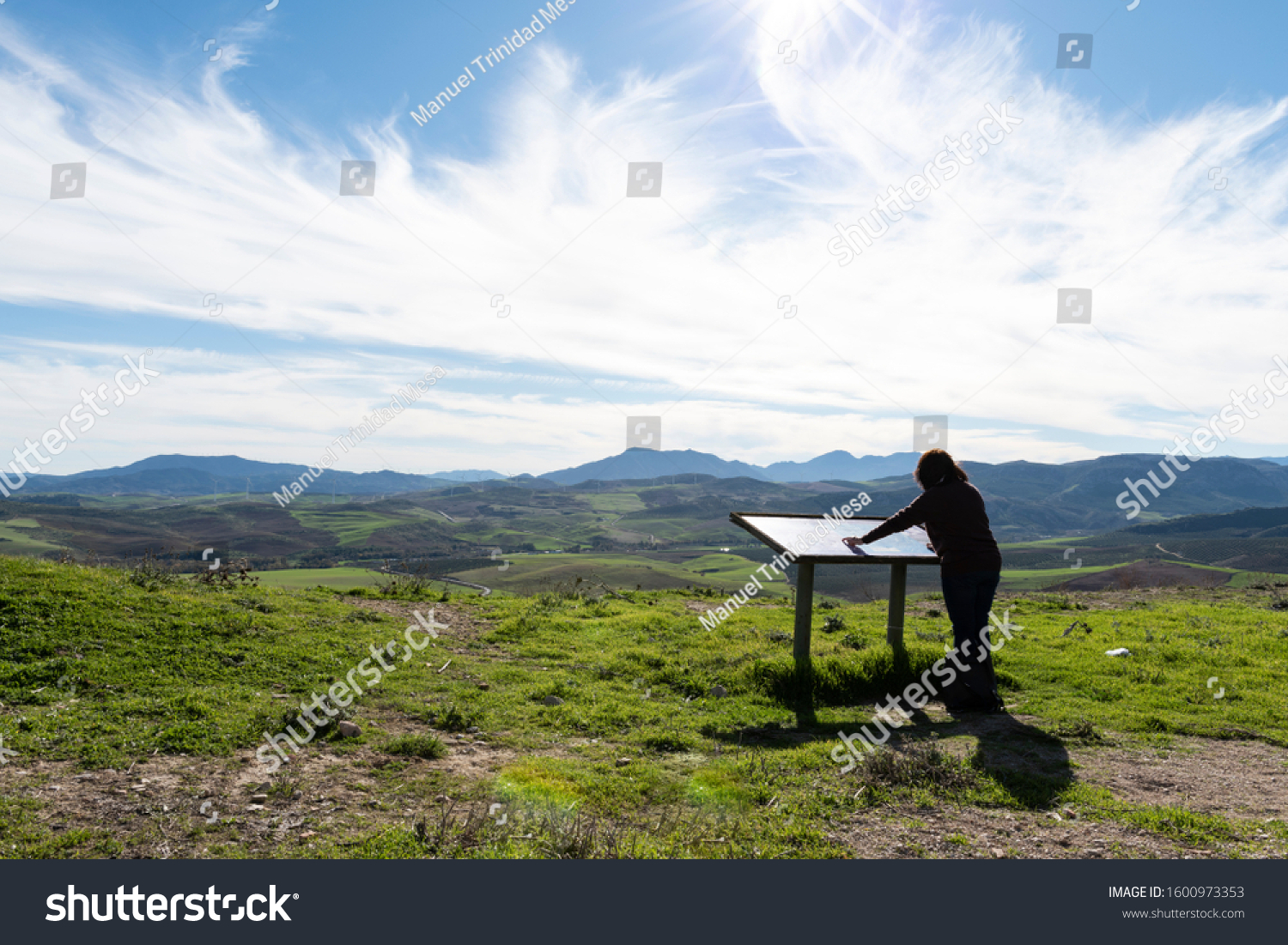 stock-photo-traveler-looking-at-the-trai