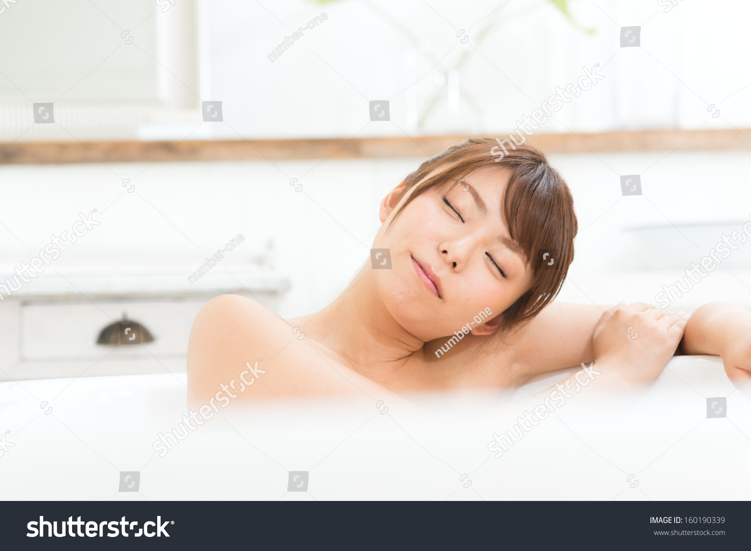 Beautiful asian woman relaxing in the bathroom stock photo 160190339 shutterstock - Relaxing japanese bathroom design for ultimate relaxation bath ...