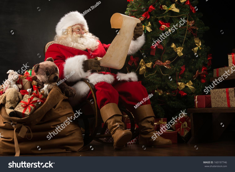 portrait happy santa claus sitting his stock photo 160197746