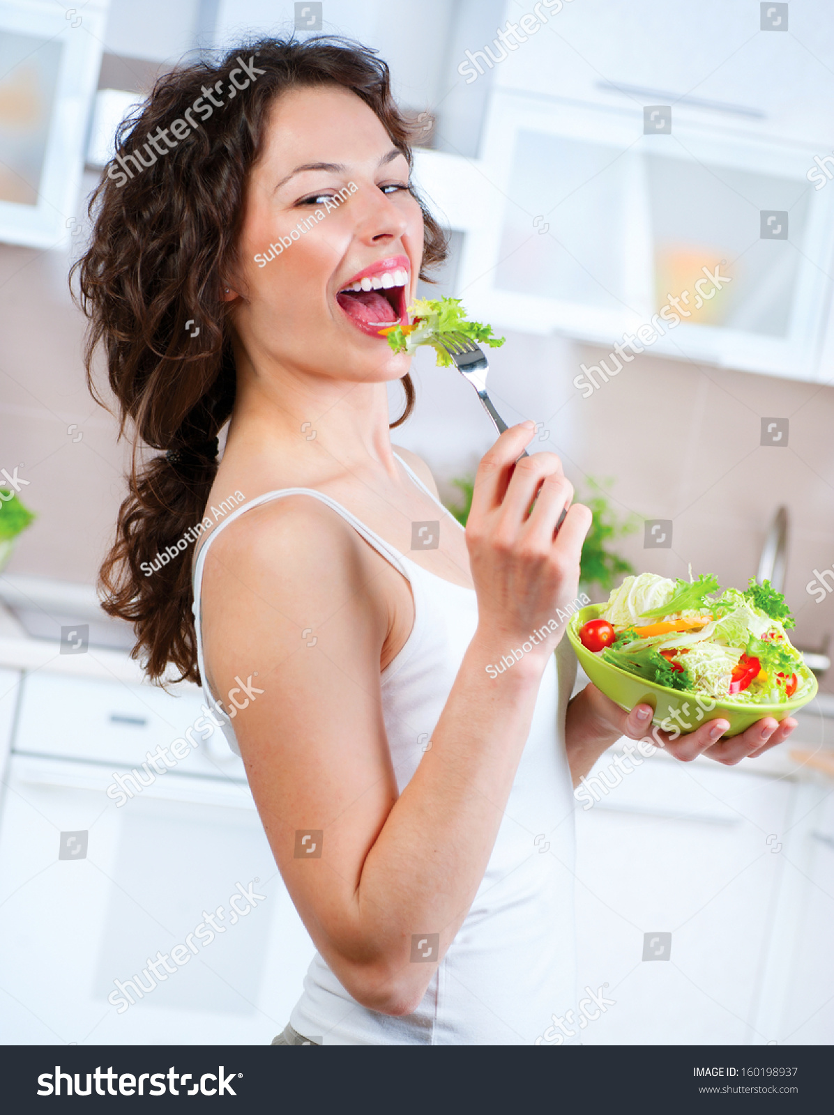 Beautiful Eat In Kitchens: Diet Beautiful Young Woman Eating Vegetable Stock Photo