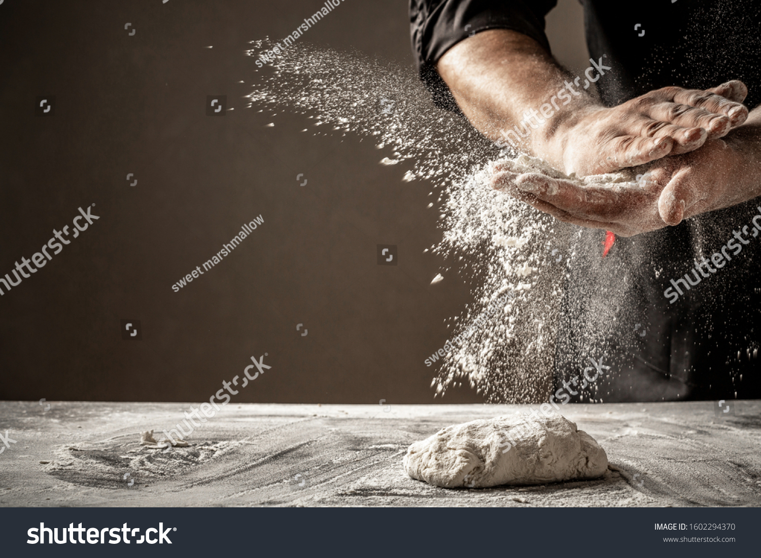 Photo of flour and men hands with flour splash. Cooking bread. Kneading the Dough. #1602294370