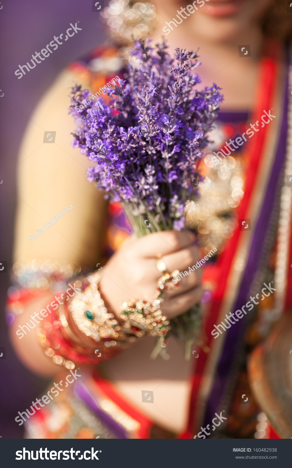 indian holding lavender flowers aromatherapy stock photo