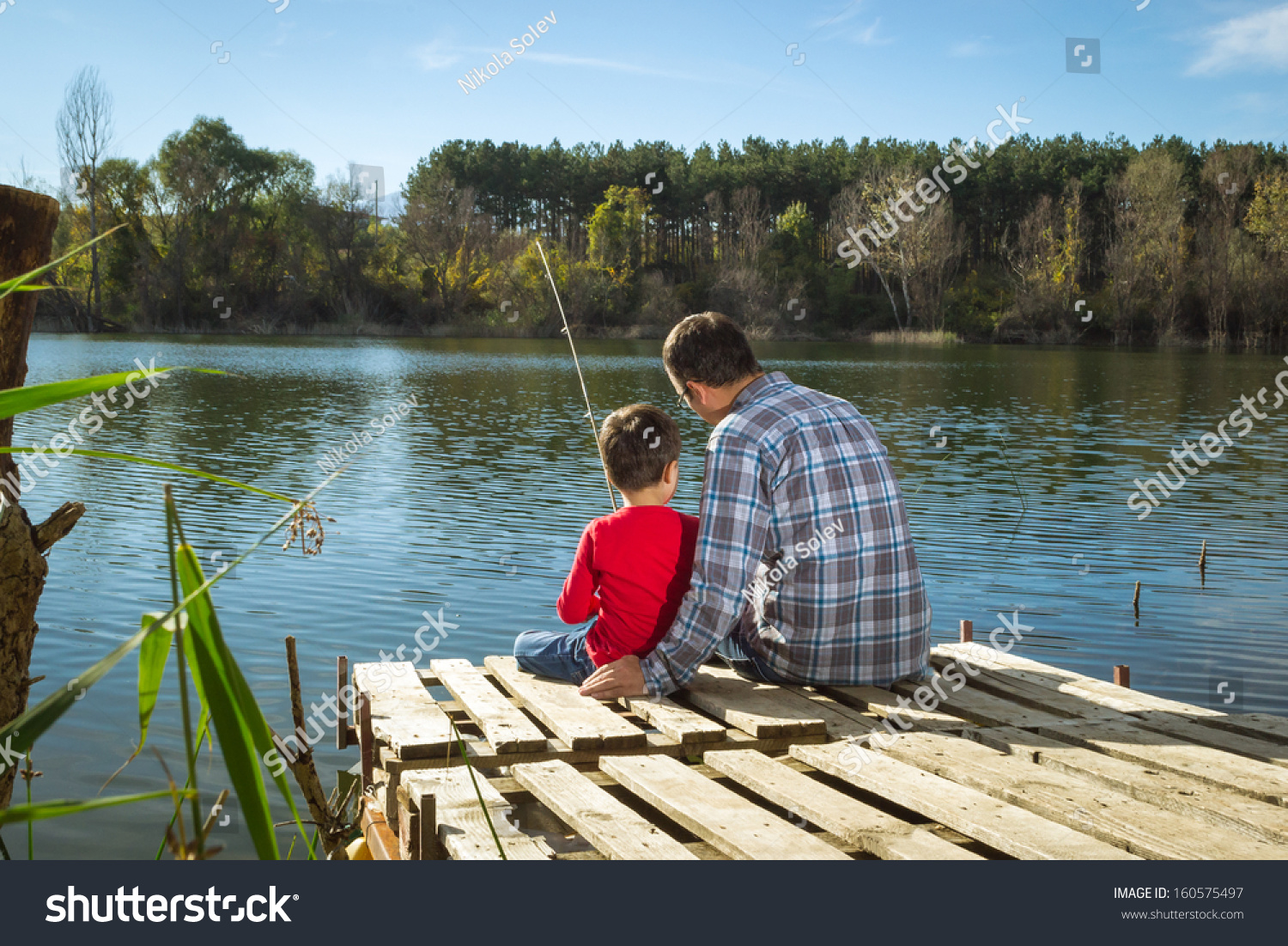 Father son fishing stock photo 160575497 shutterstock for Father son fishing