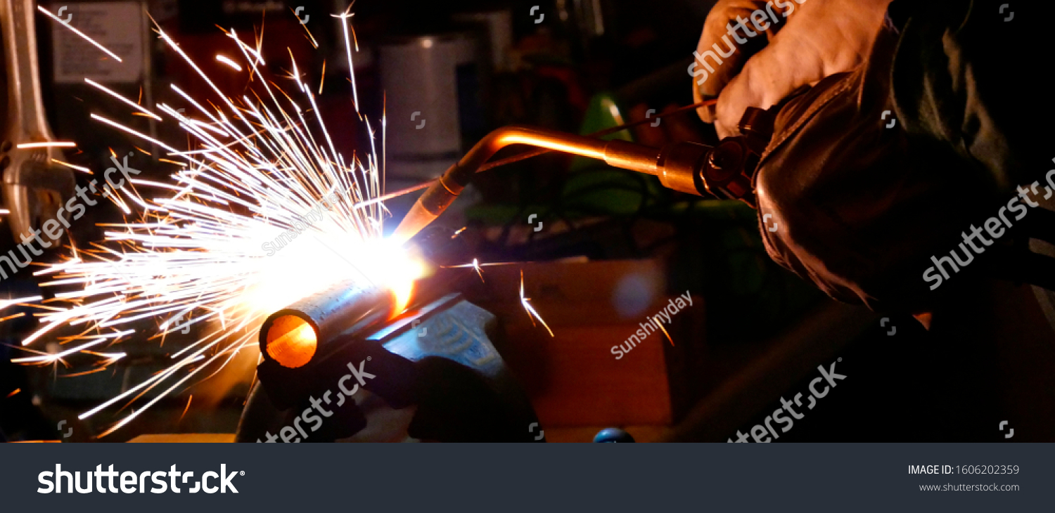 Welding using an oxyacetylene flame autogeneous cutting metalwork welder sparks