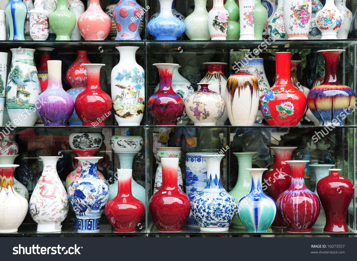 Colorful glazed chinese ceramic vases various stock photo 16073557 the colorful glazed chinese ceramic vases of various shapes and sizes on the shelf reviewsmspy