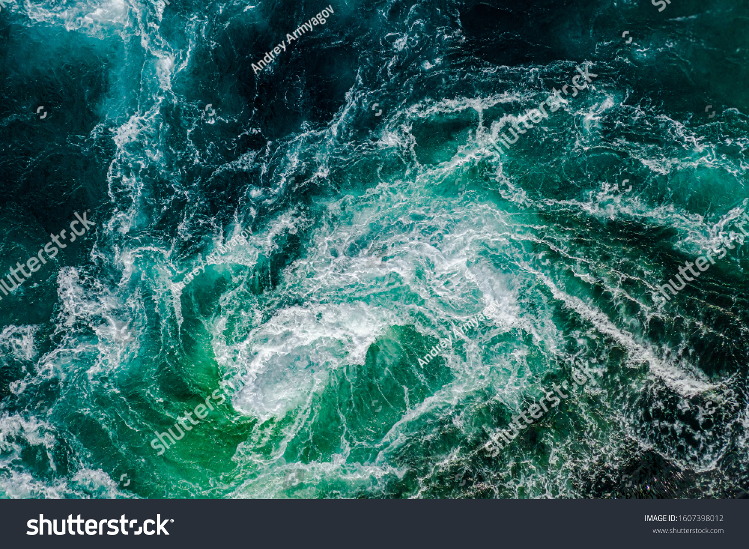 Abstract background. Waves of water of the river and the sea meet each other during high tide and low tide. Whirlpools of the maelstrom of Saltstraumen, Nordland, Norway #1607398012