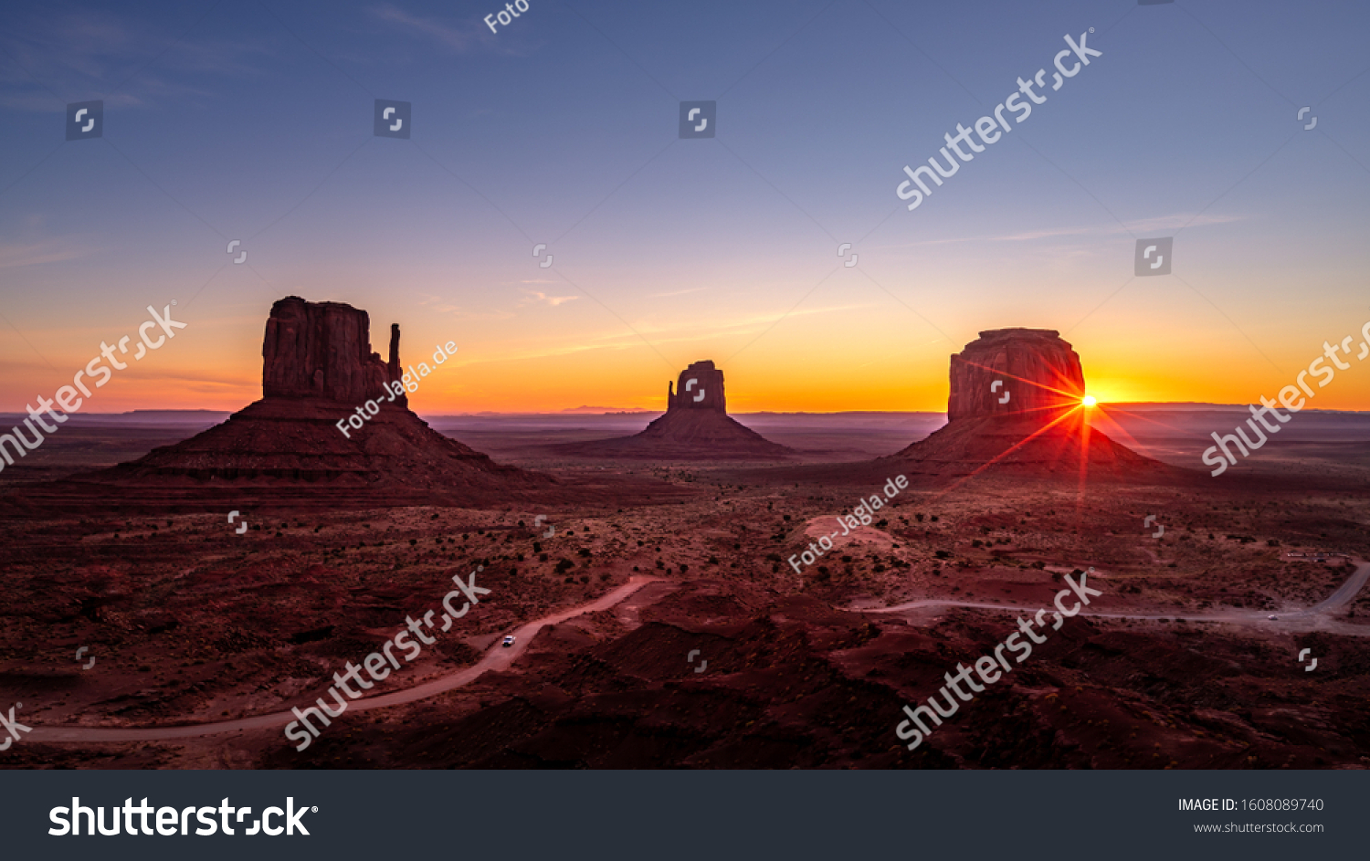 Beautiful sunrise over the red rocks of Monument Valley in Arizo #1608089740