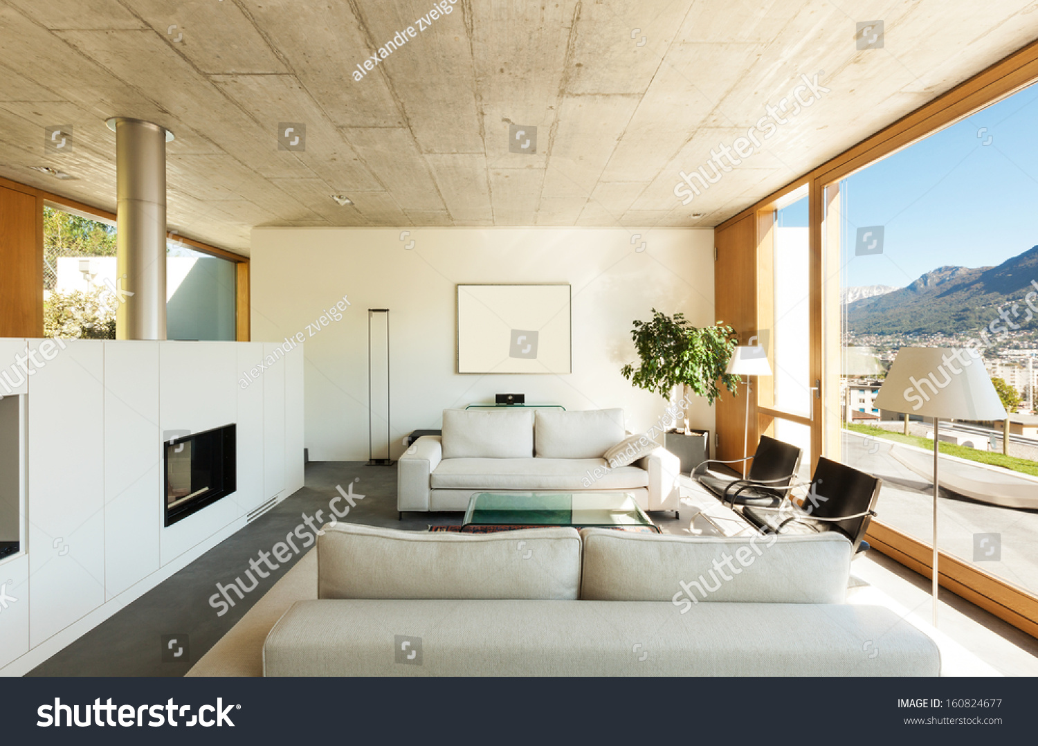Beautiful modern house cement interiors view stock photo for Modern house living room