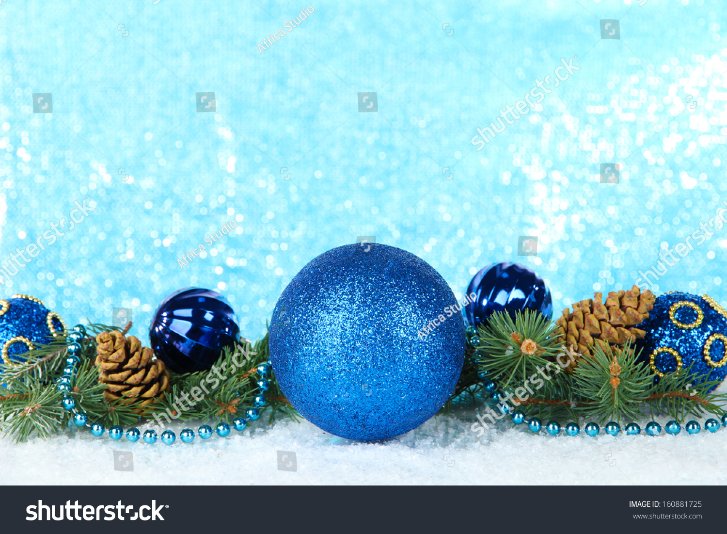 Turquoise and golden christmas ornaments border on white background
