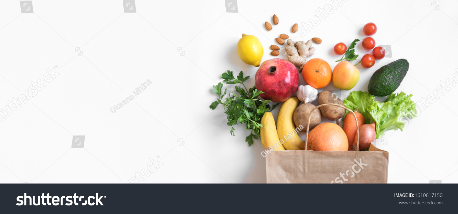 Healthy food background. Healthy vegan vegetarian food in paper bag vegetables and fruits on white, copy space, banner. Shopping food supermarket and clean vegan eating concept. #1610617150
