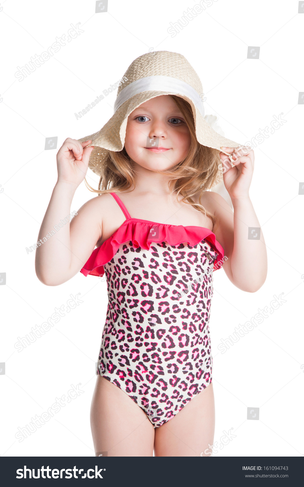Little blonde happy girl in pink swimsuit holding hat over white background  Stock Photo 876012bd3ac5
