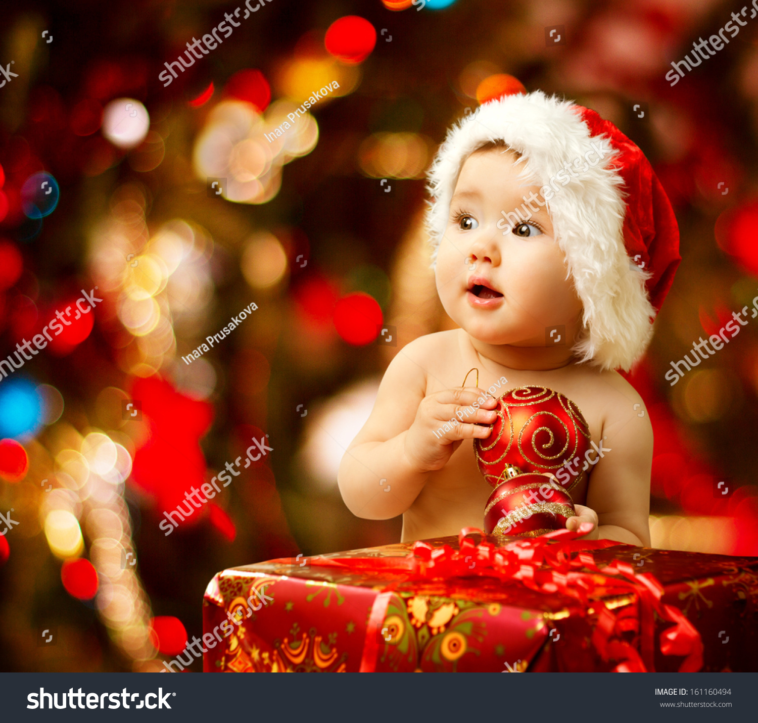 Christmas Baby Santa Hat Child Holding Stock Photo