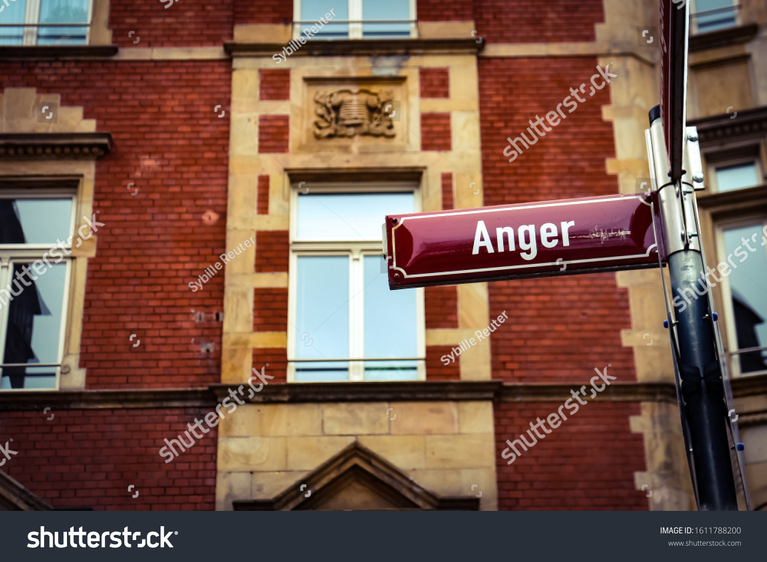 stock-photo-red-anger-street-sign-in-fro