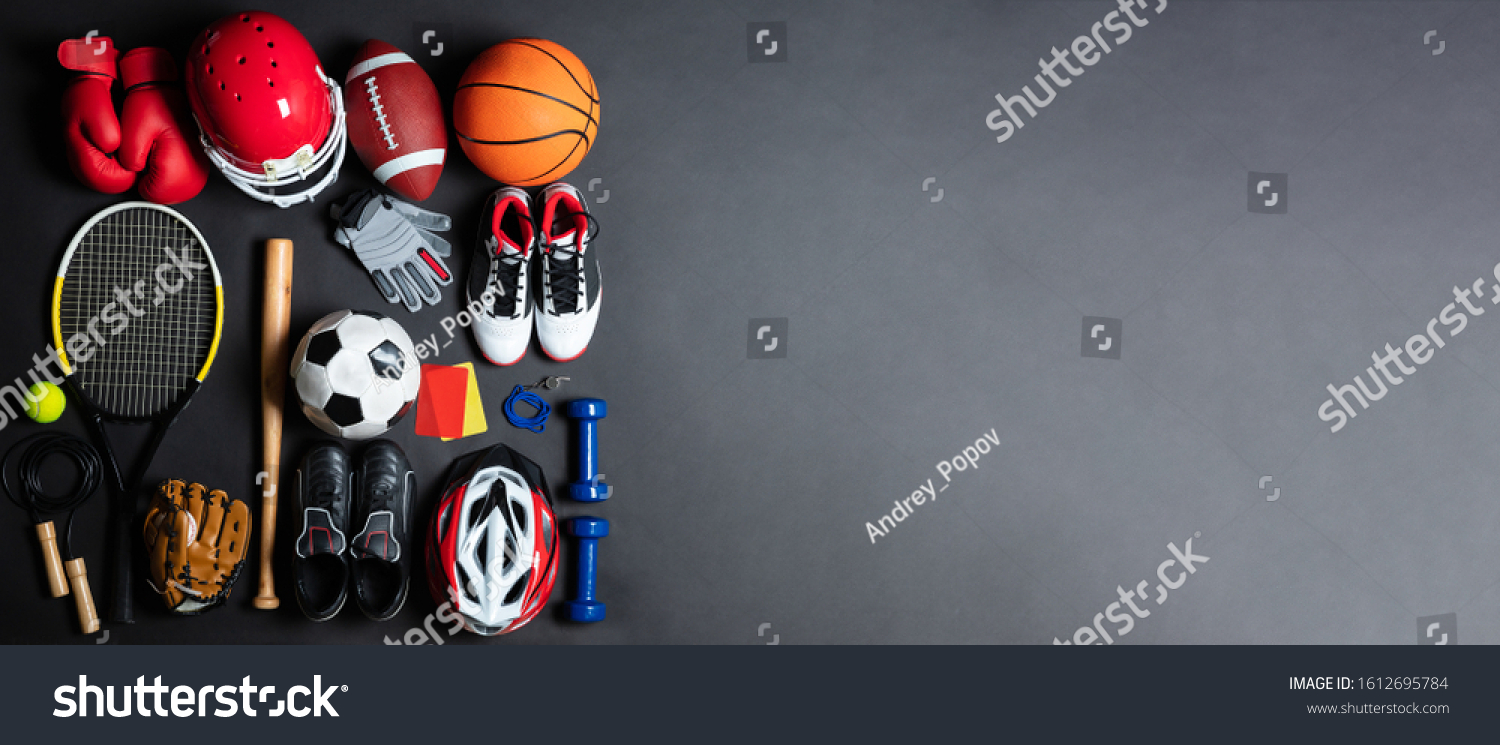An Overhead View Of Different Sports Equipment On Gray Background #1612695784