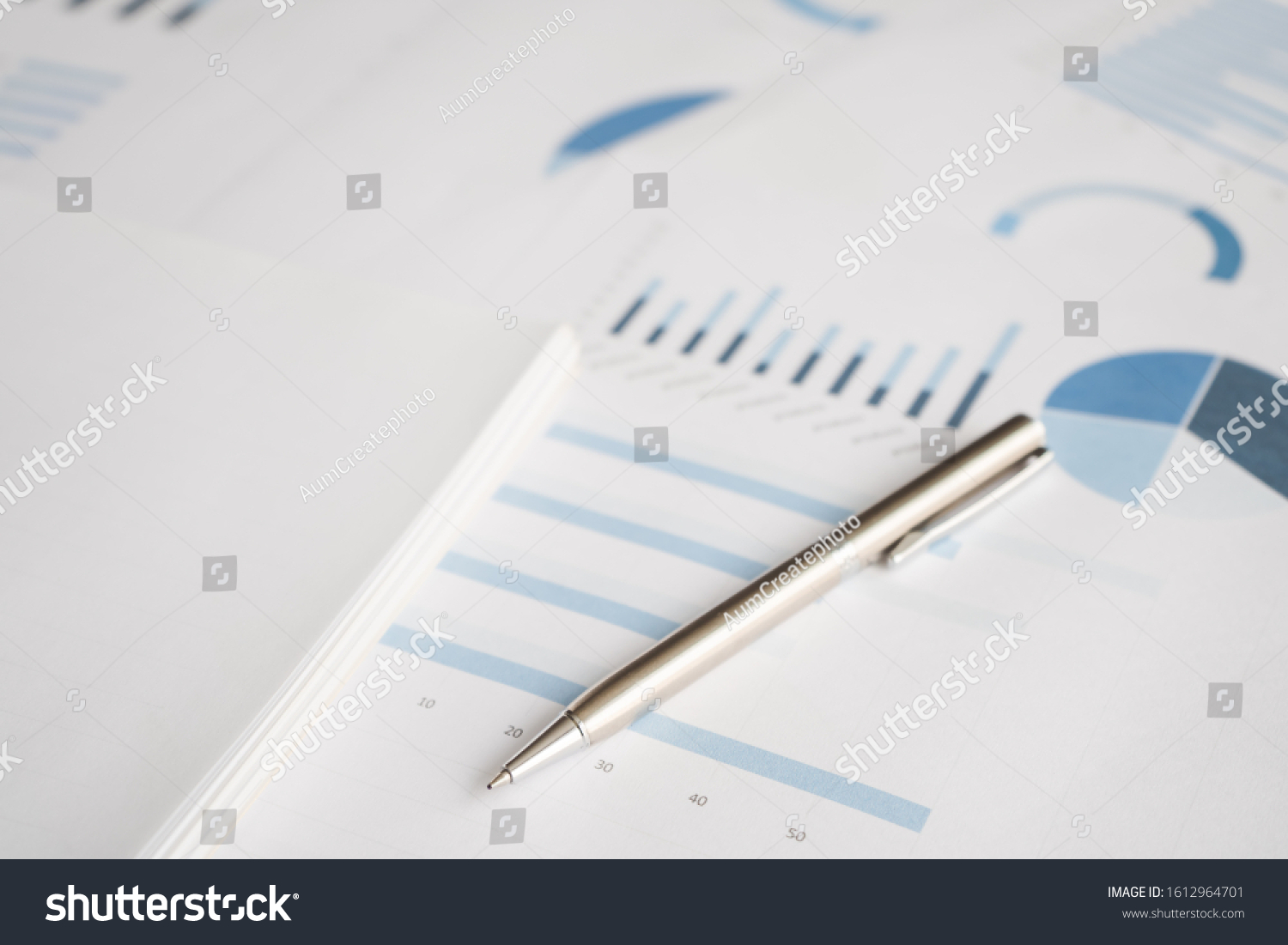 Business document report data with bar charts, pie charts, line graphs, on paper. Research data for market analysis and corporate financial planning. #1612964701