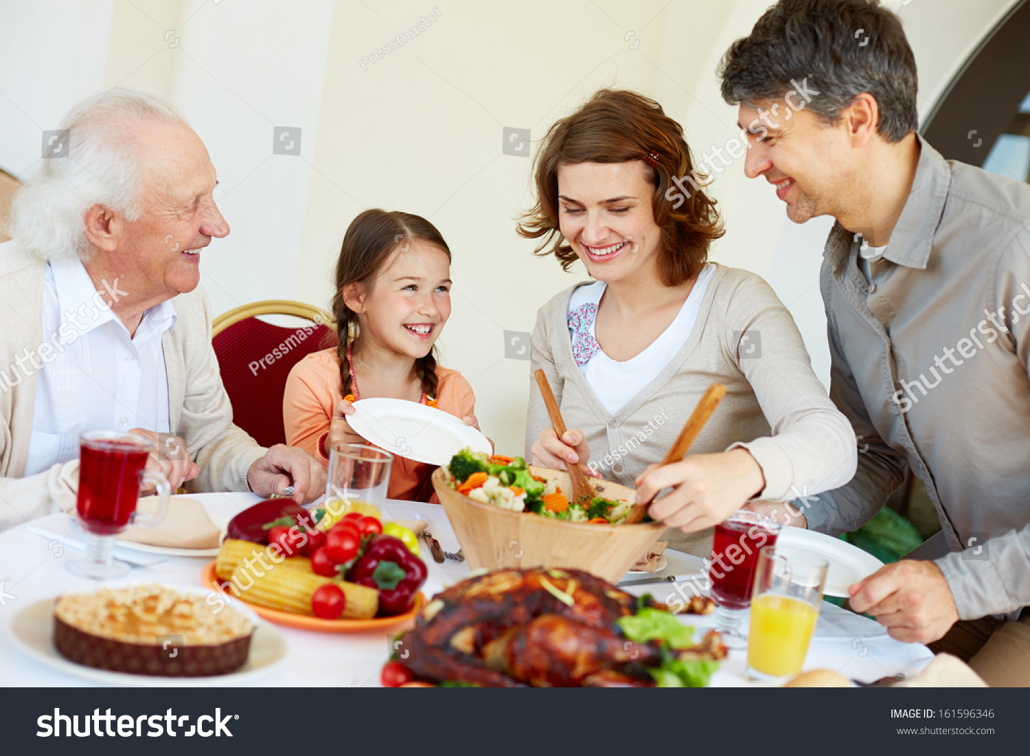 portrait of happy family sitting at festive table while