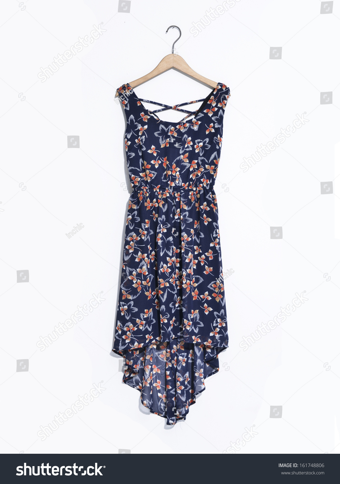 Modern stylish dress isolated on hangers stock photo 161748806