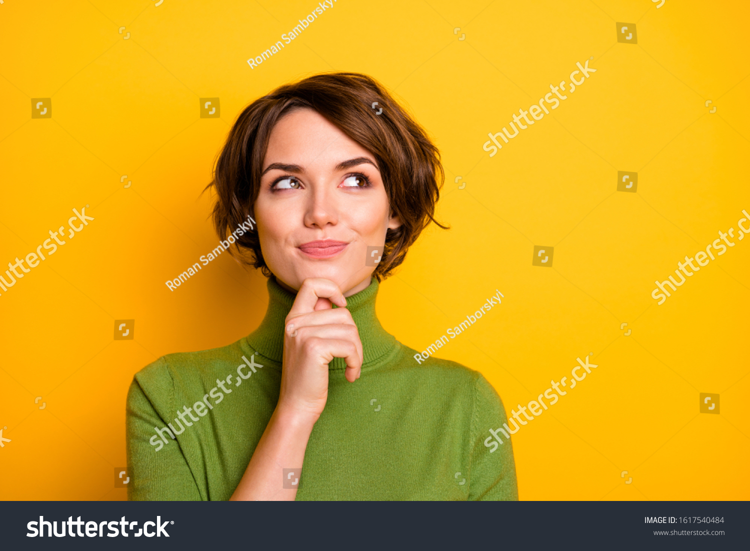 Closeup photo of amazing short hairdo lady looking up empty space deep thinking creative person arm on chin wear casual green turtleneck isolated yellow color background #1617540484