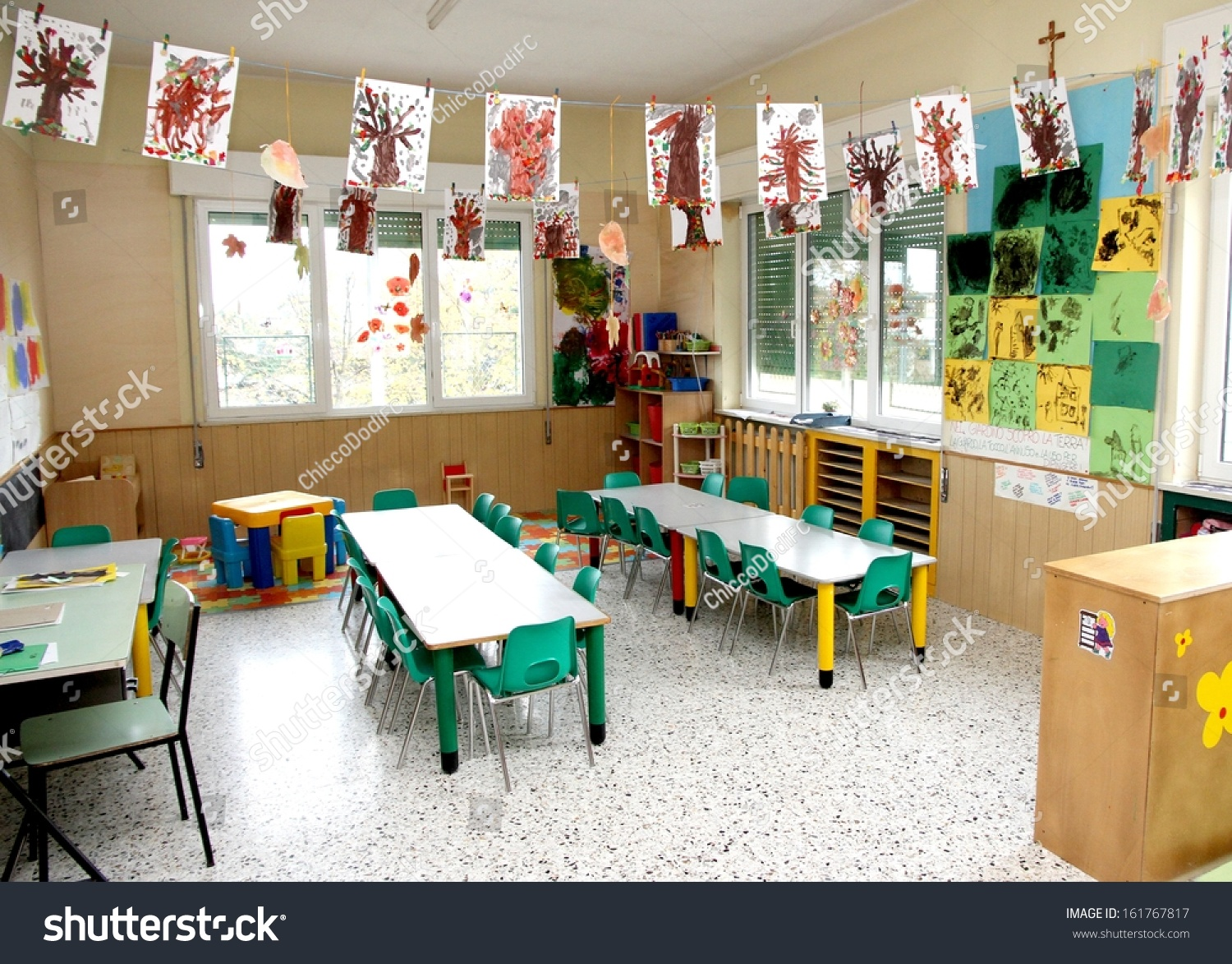 In A Class Of Nursery With Drawings Children Hanging