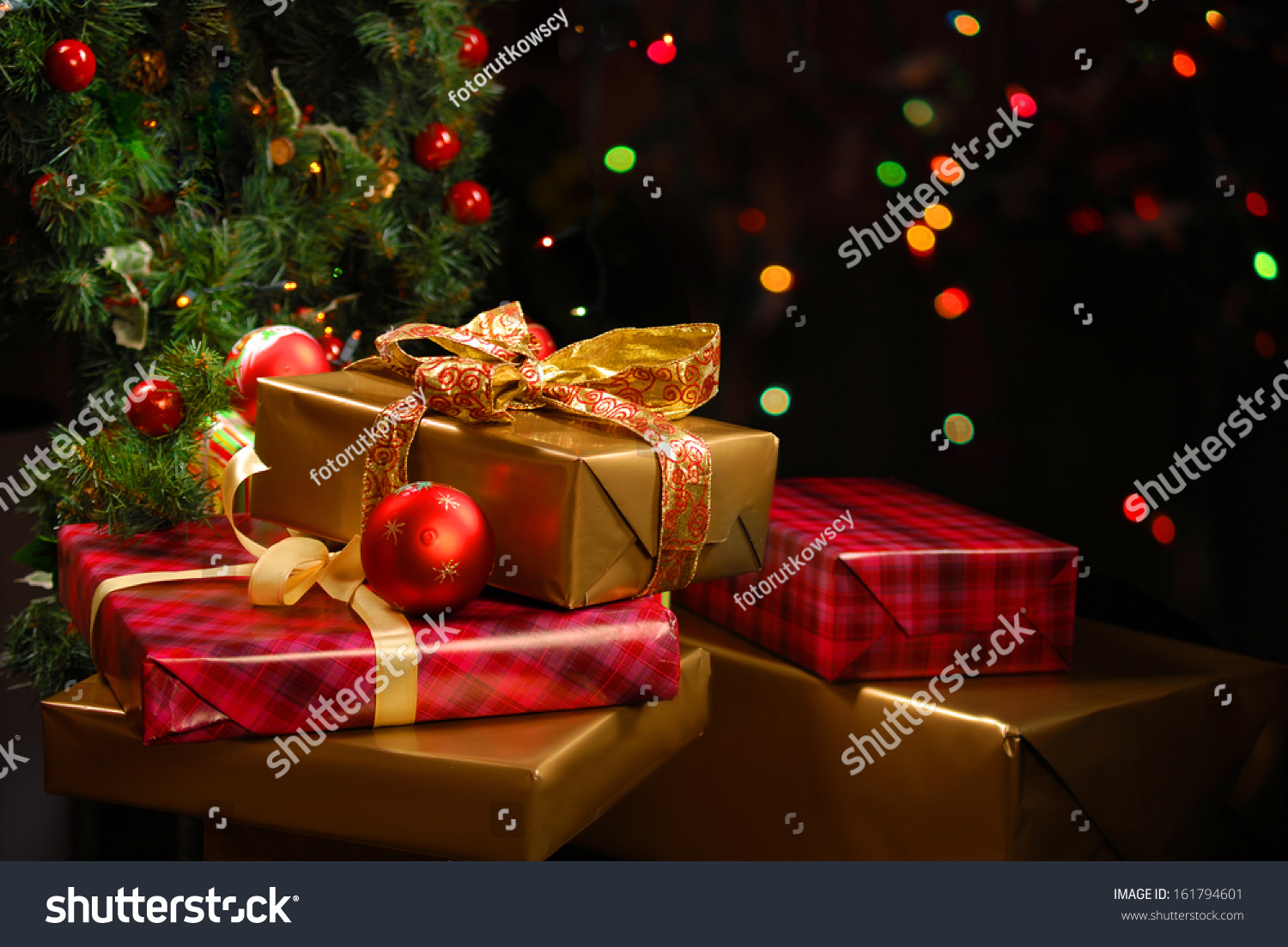 Christmas tree with presents and lights - Gifts Under The Christmas Tree Lights Background Preview Save To A Lightbox