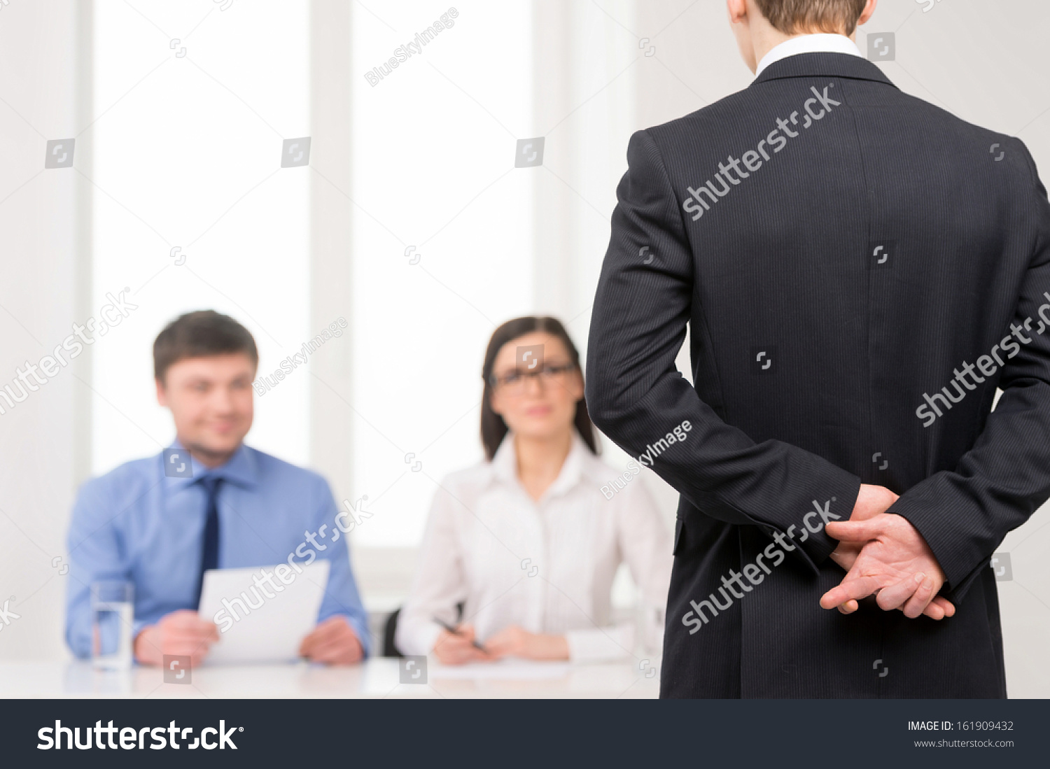close man back fingers crossed behind stock photo