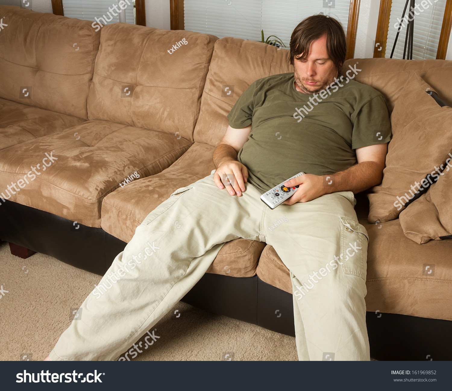 obese guy sitting on couch his stock photo 161969852. Black Bedroom Furniture Sets. Home Design Ideas