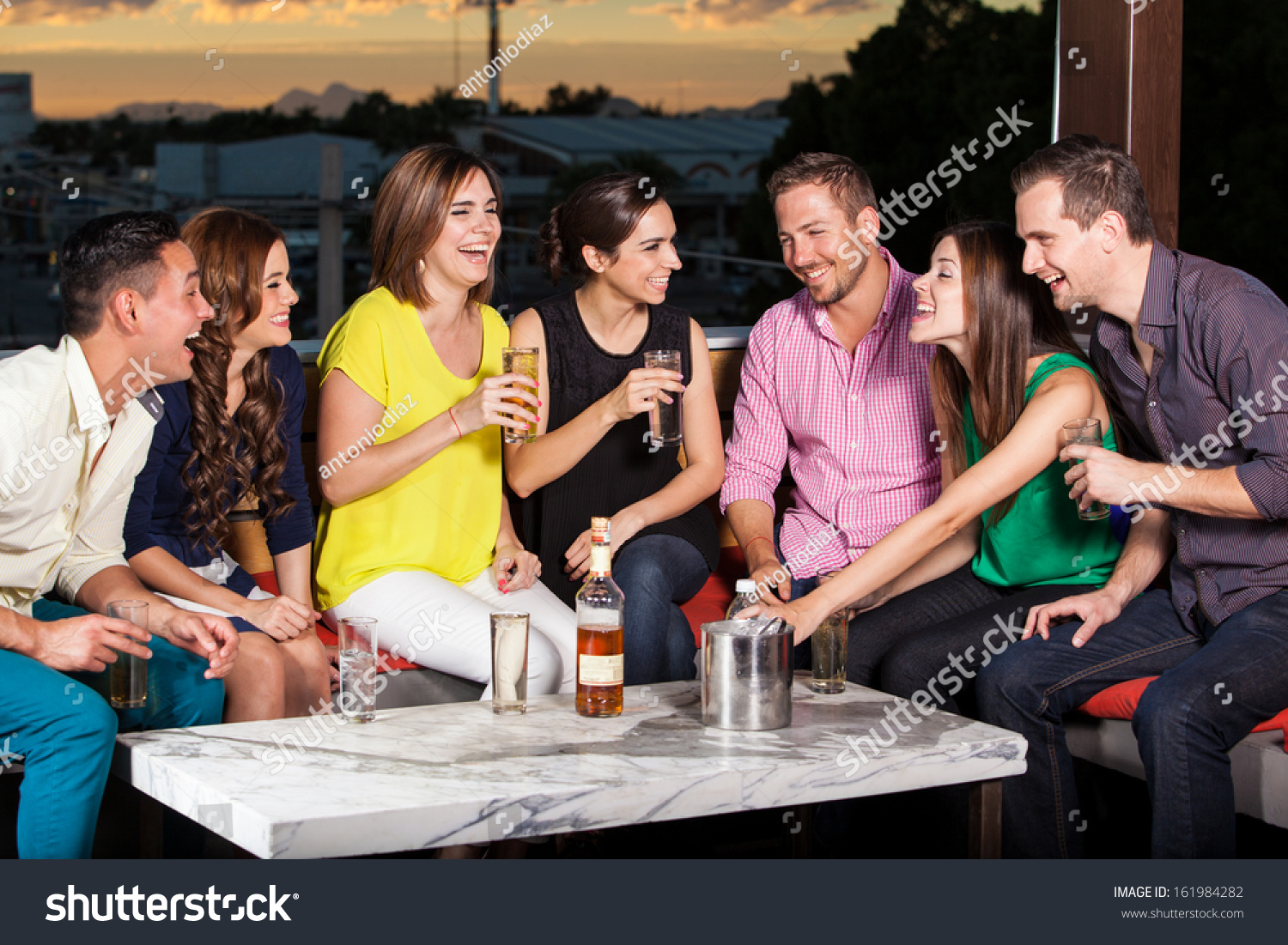 Group of young hispanic adults having drinks in a terrace for The terrace group