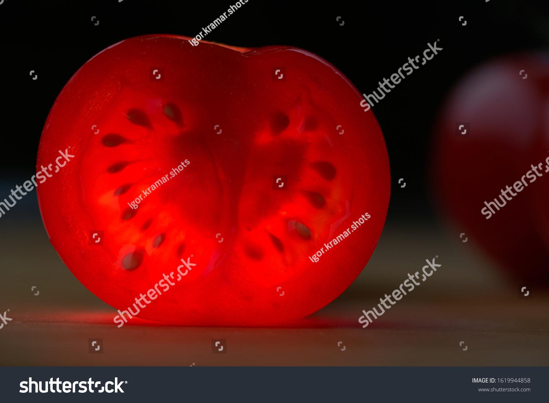 stock-photo-slice-of-red-cherry-tomato-w