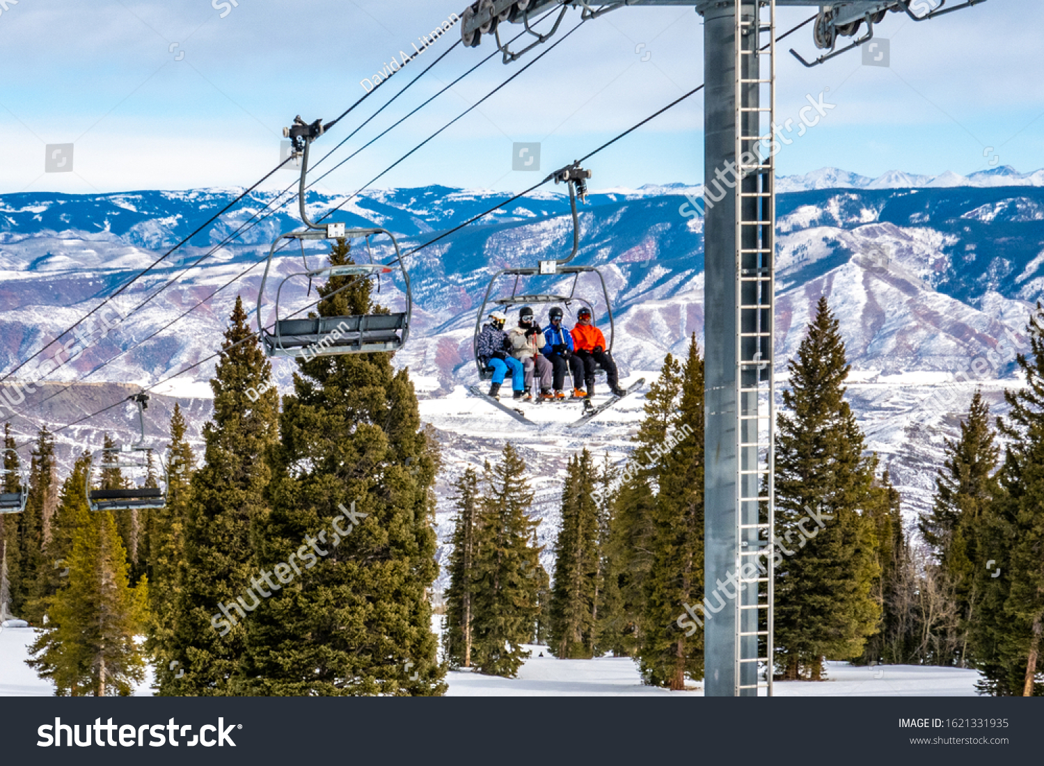stock-photo-skiers-and-snowboarders-asce