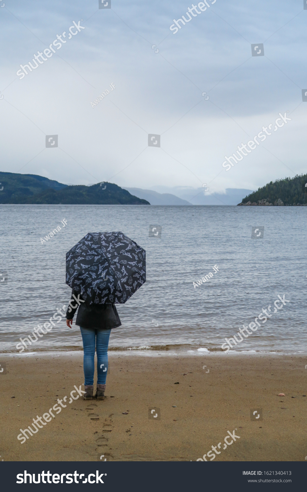 stock-photo-back-view-of-a-woman-standin