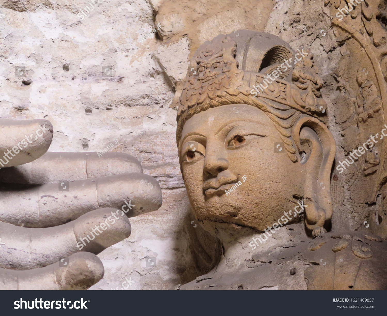 stock-photo-closeup-of-fingers-and-buddh