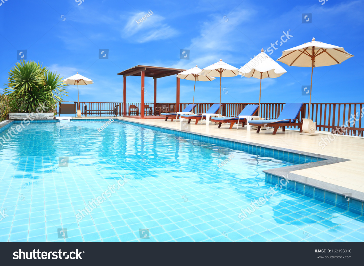 Pool On Top Of Building : Swimming pool on top roof deck stock photo