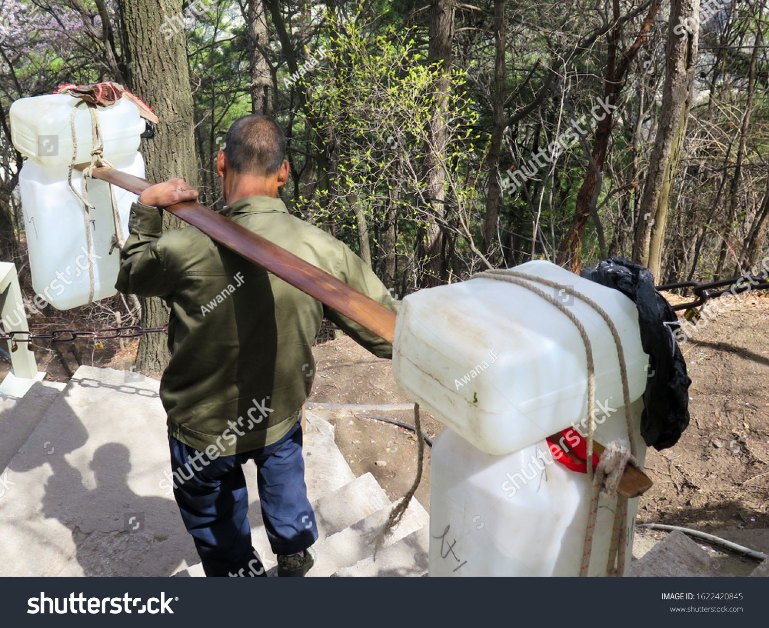 stock-photo-chinese-man-carrying-water-j