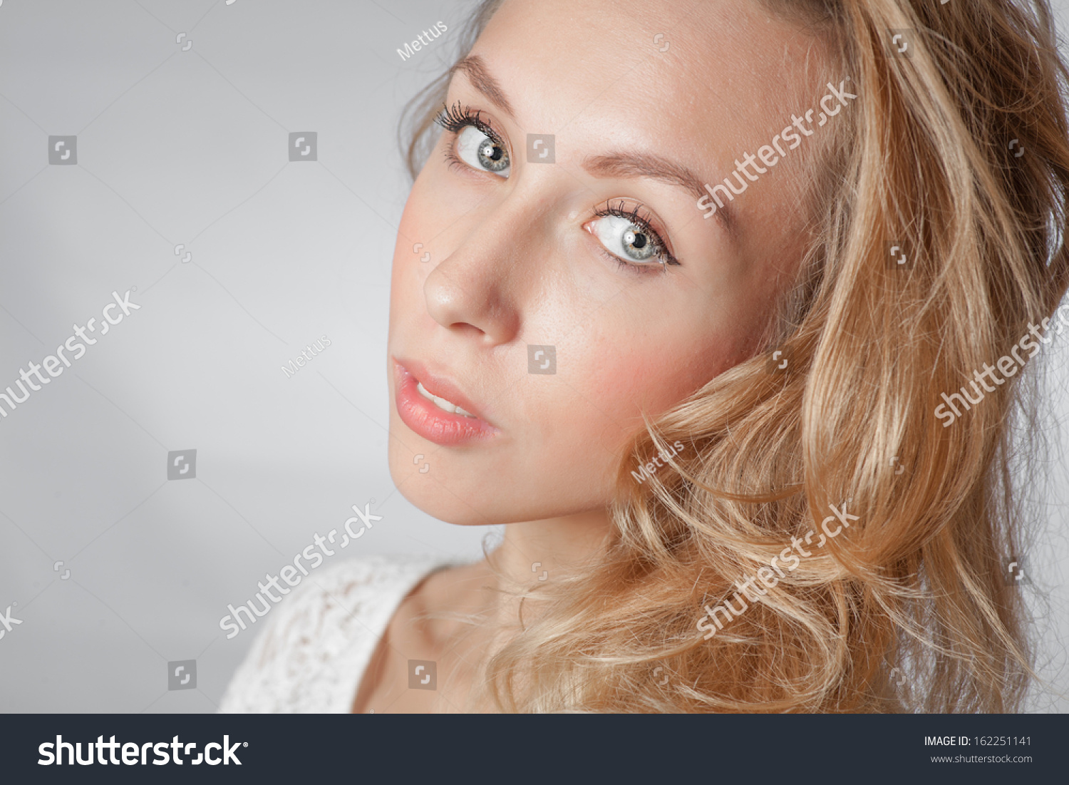 closeup of the face, blond women with long hair studio shot on white background