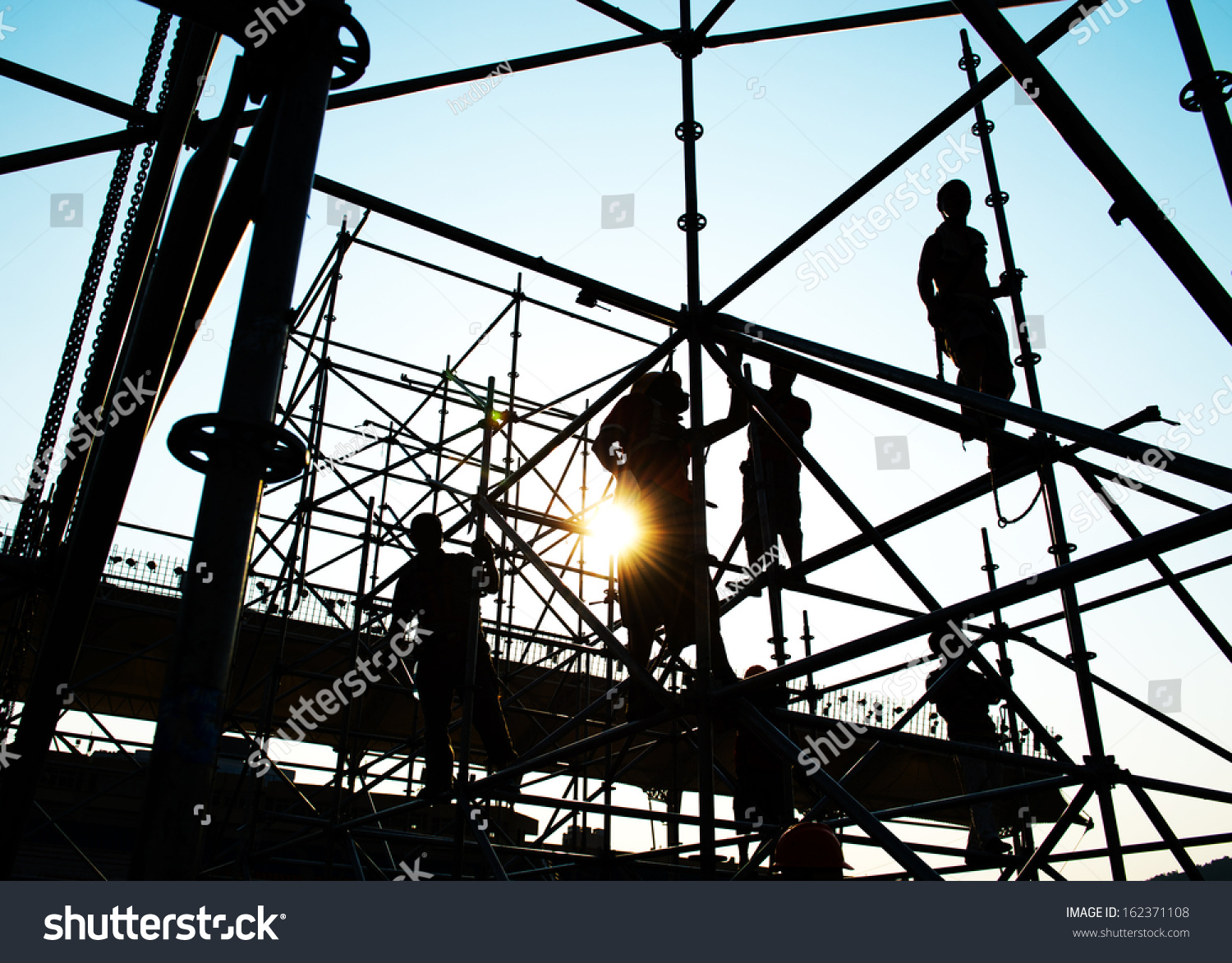 Working On Scaffolding : Construction workers working on scaffolding stock photo