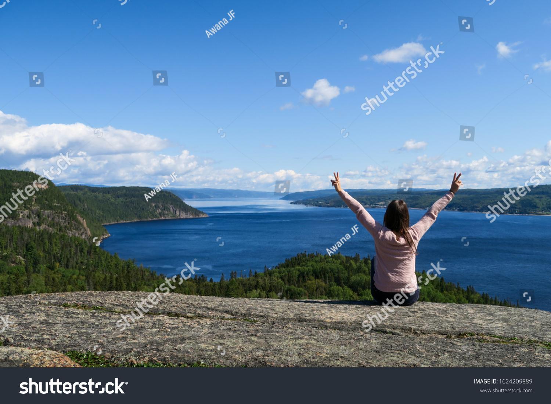 stock-photo-joyful-young-woman-sitting-o