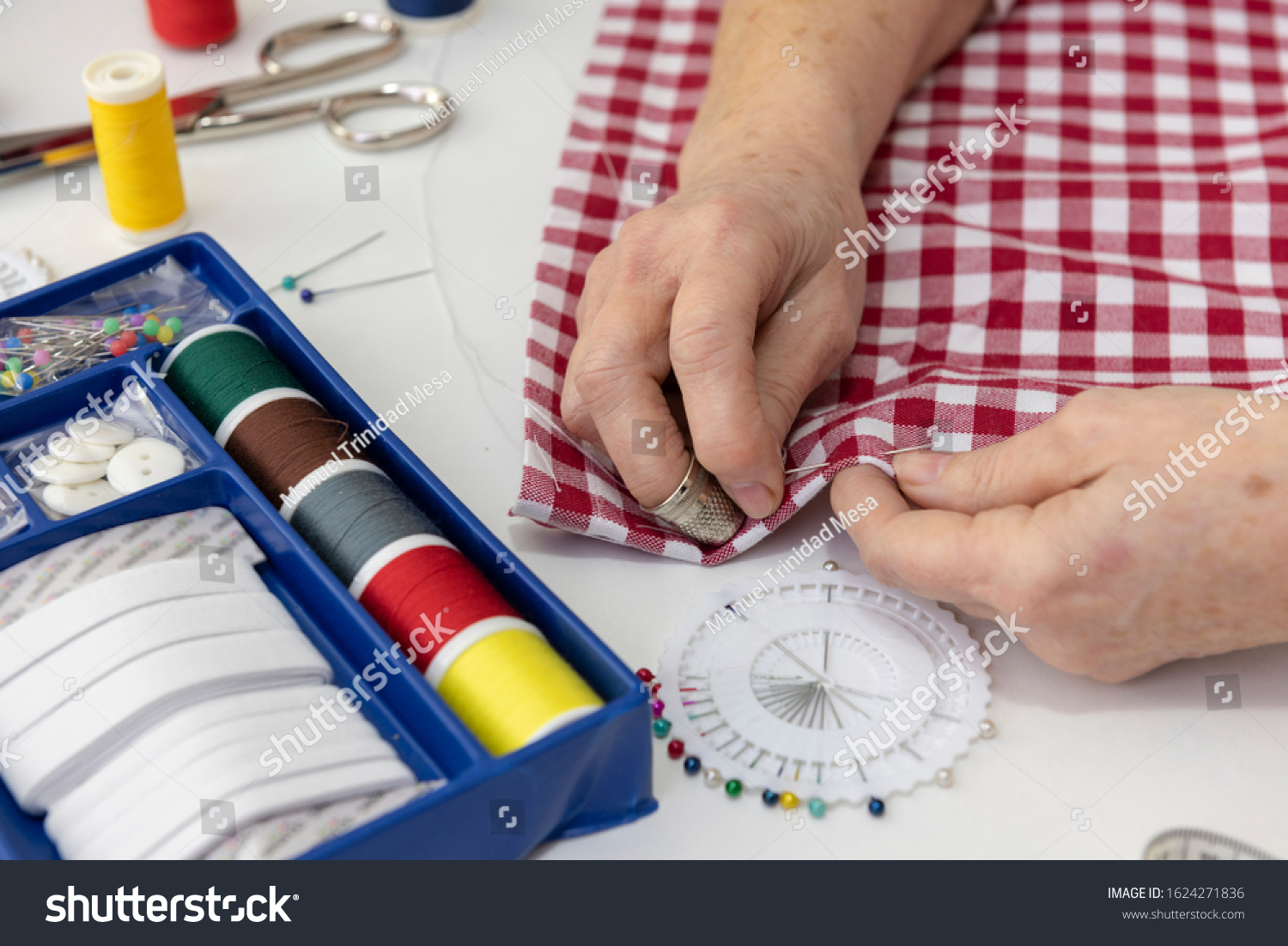 stock-photo-seamstress-sewing-with-needl