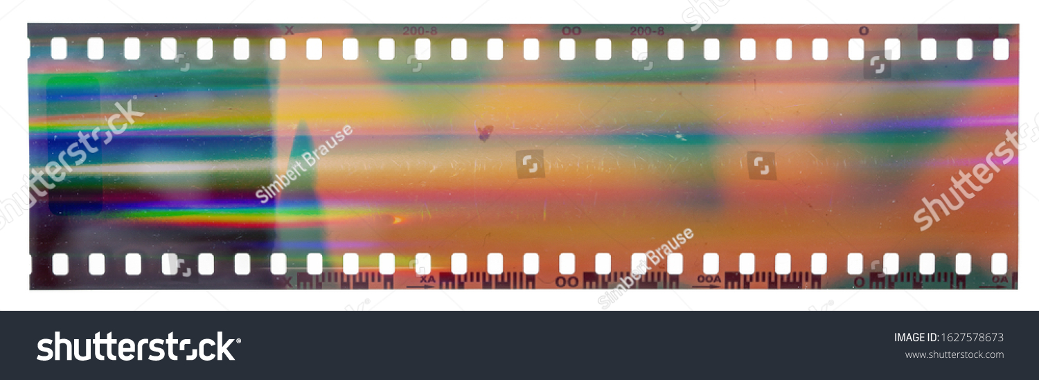 Start of 35mm negative filmstrip, first frame on white background, real scan of film material with cool scanning light interferences on the material. #1627578673