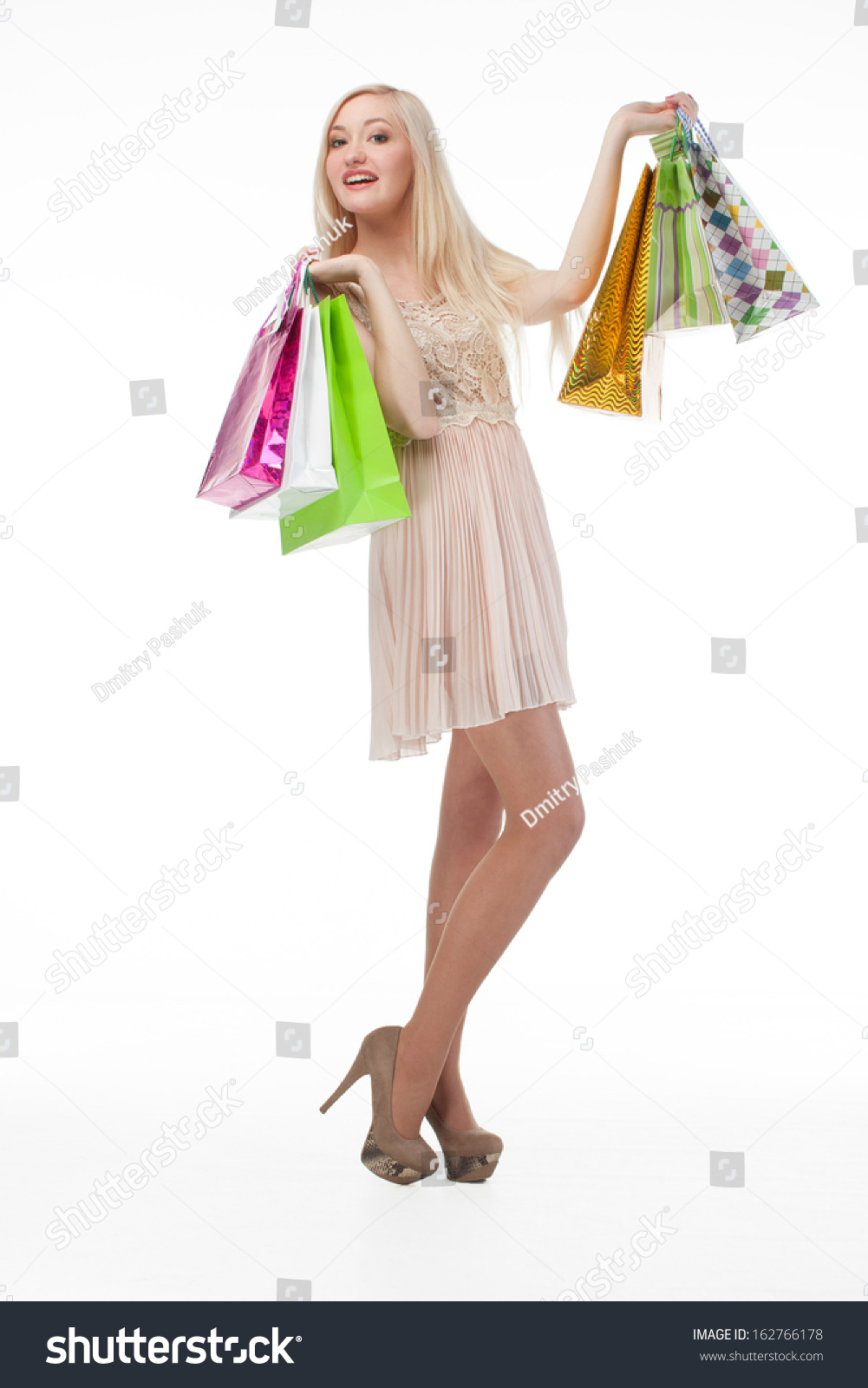 Woman posing with shopping bags isolated on white background full - Beautiful Young Woman Posing With Shopping Bags Isolated On White Background