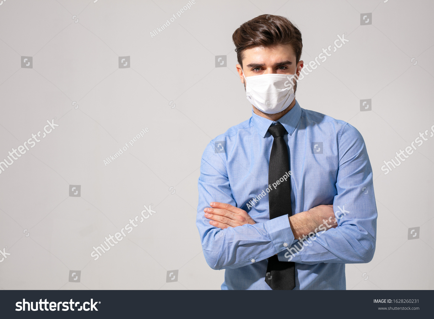 is time to protect all the time. elegant man wearing a mouth protection to prevent getting sick at work or on the way to work #1628260231
