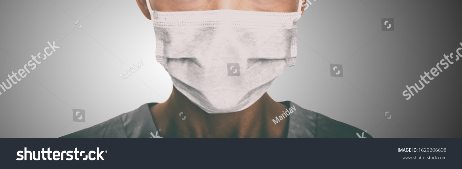 Doctor wearing protection face mask against coronavirus. Banner panorama medical staff preventive gear. #1629206608