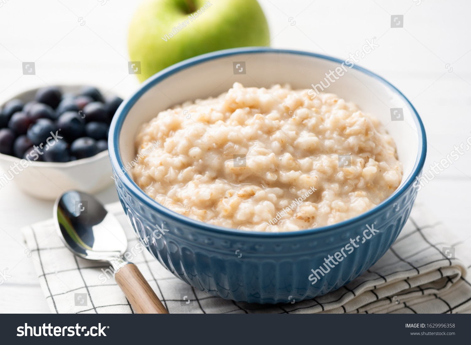 Healthy breakfast oatmeal porridge in bowl. Warm porridge oats, vegan vegetarian weight loss dieting breakfast food #1629996358
