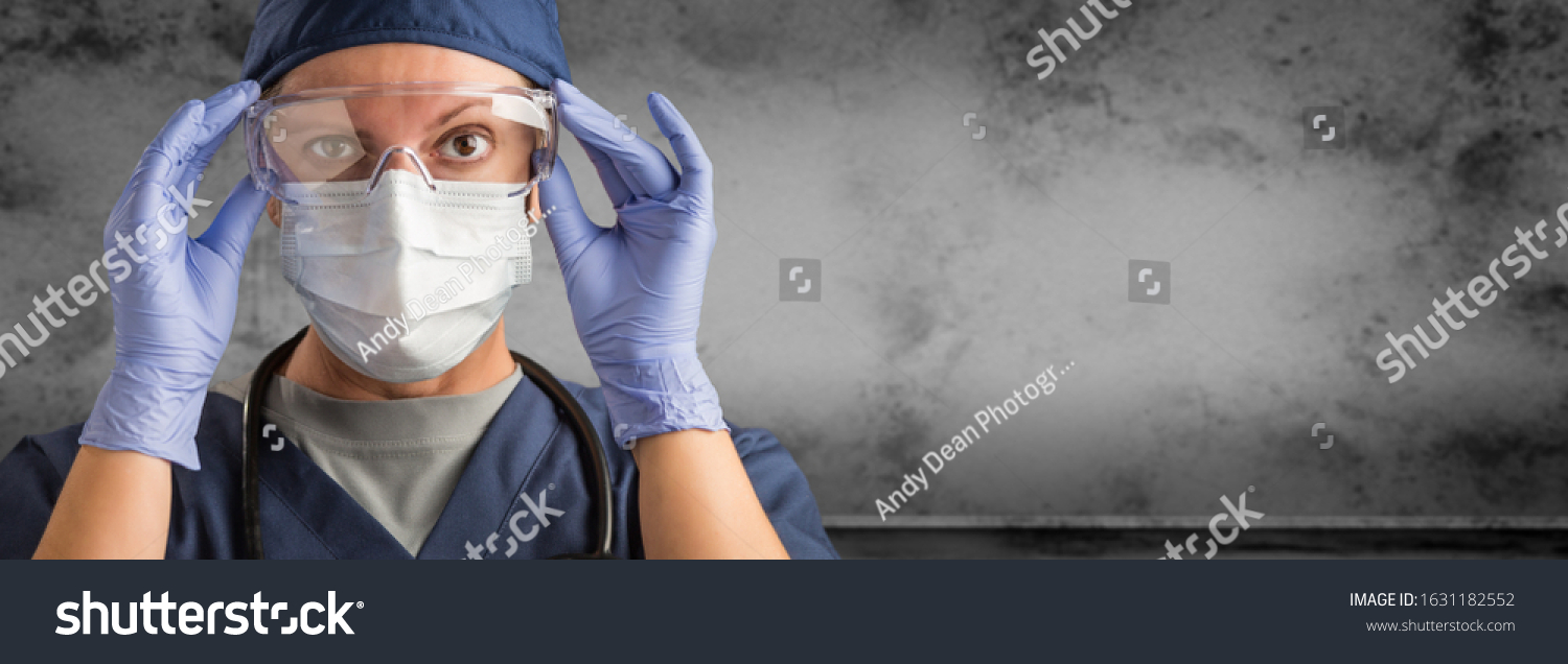 Female Doctor or Nurse Wearing Scrubs and Protective Mask and Goggles Banner. #1631182552